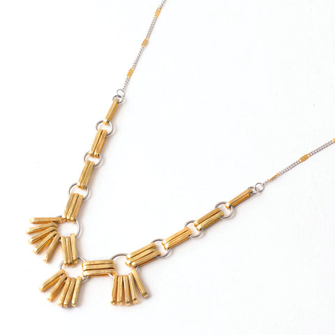 "Laure pendant in 22k matte gold-plated bronze and pewter, measuring 18"" in length."