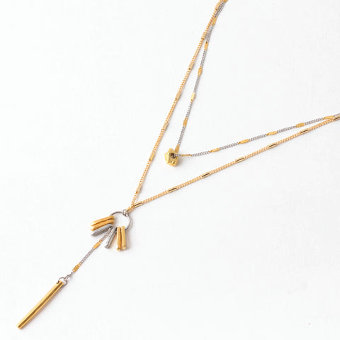 "Gaby pendant with a double strand and dramatic drop in 22k matte gold-plated bronze and pewter, measuring 18"" in length."