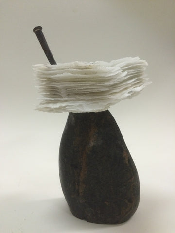 Finding Balance, cast glass sculpture with nail on a concrete base by Cheryl Wilson Smith.