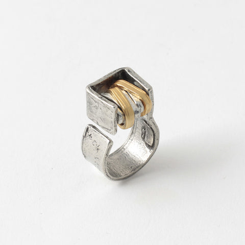 Paloma ring is plesasantly light in weight for it's bold industrial design. Approx. size 7.5, but can be stretched slightly larger or smaller. In pewter and 22k gold on bronze.