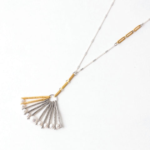 "Francesca pendant fans out with 22k matte gold-plated bronze and pewter with pearls measuring 17"" in length."
