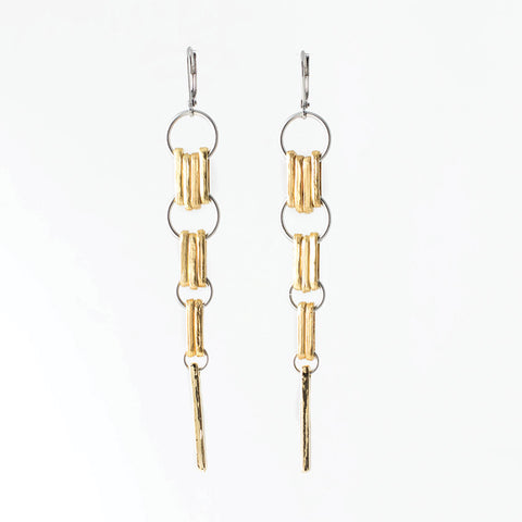 "Verlaine earrings are long 22k gold-plated bronze and pewter. They measure 3.5"" in total length x 0.5 across and are light in weight."