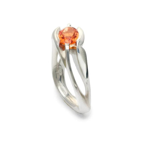 Unison, ring in sterling silver with lab-created padparadscha sapphire.(8 x 6mm).  Ring size: 6.5  This ring features an asymmetrical design and can be worn on either hand. The square shank helps the ring remain upright and adds strength and longevity.