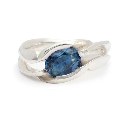 Unison, ring in sterling silver with London blue topaz.(8 x 6mm).  Ring size: 5.5  This ring features an asymmetrical design and can be worn on either hand. The square shank helps the ring remain upright and adds strength and longevity.
