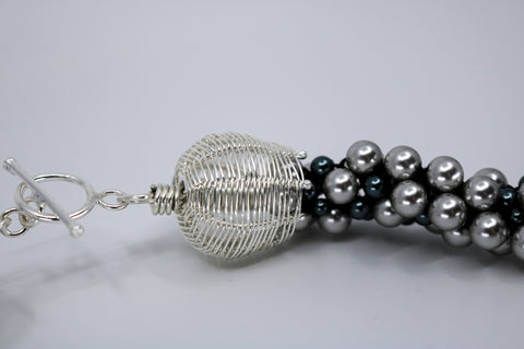 "Dot Necklace has about 8 separate strands of Swarovski pearls tightly braided in the Kumihimo technique. The sterling silver clasp is hand-made and can be worn as the centrepiece, off-centre, or to the back of this 19"" long fine necklace., detail"