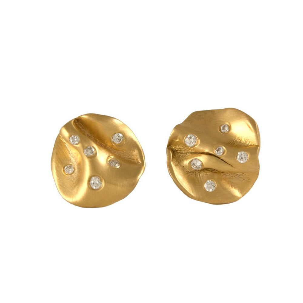 Annie Tung 14K gold stud earrings studded with diamonds.