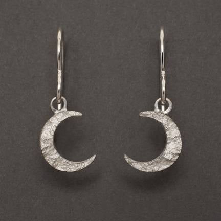 Allyson Simmie's Crescent moon earrings in sterling silver textured by the impression of granite. Currently available as drops studs 25 x 5 c or studs, 10 x 6 mm; contact us for Crescent Moon Drops.