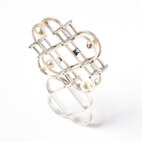Oscillation Ring in sterling Silver, 14k Yellow Gold, Fresh Water Pearls, Sky Blue Topaz, Pink Topaz, Citrines. This ring measures 4.8 x 1 x 7.7 cm and was created in 2021.