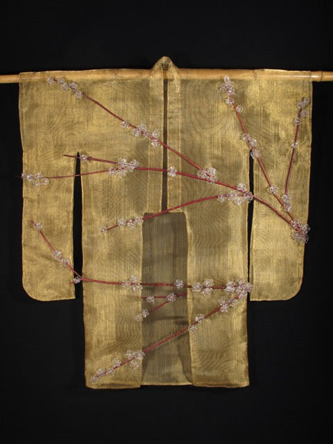"""Blossoming"". a shimmering gold kimono of flame worked glass, copper wire, brass mesh & dogwood branches."