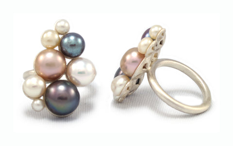 Blush ring, horizontal placement of freshwater pearls in sterling silver. Size 6.
