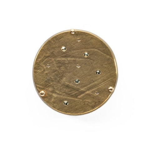 Brass disc brooch on a sterling silver back plate with 18k gold and marcusite details; diameter 3 cm