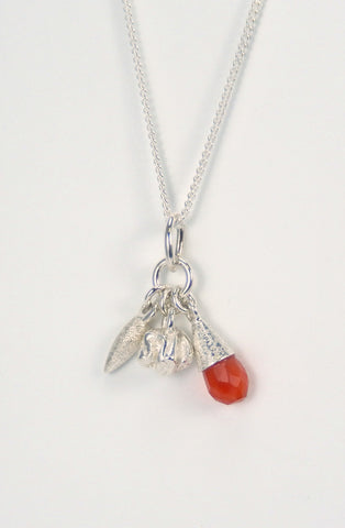 Cluster pendant with drop, crinkle ball and carnelian briolette on a sterling silver curb chain.