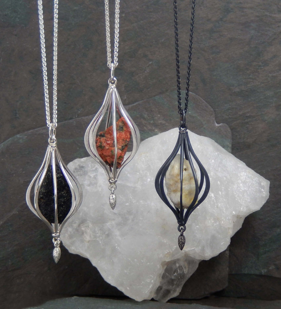 Canadian Shield pendant in sterling silver and uncut Lanark County granite on a wheat chain. Center and right pendants available, $395 each.