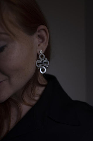 Chainmaille Tidal Earrings are in an exotic combination of sterling silver with hand-cut acrylic and, mother-of-pearl.