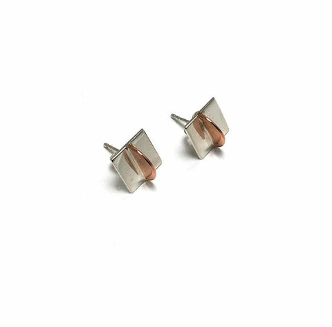 Small square studs created in sterling silver and copper. 9mm x 9mm