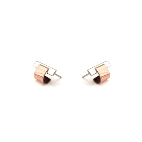Cuff earrings created in sterling silver and copper. 115mm x 10mm x 10mm