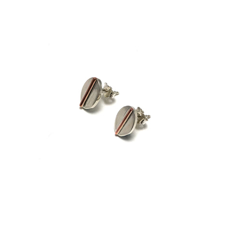 Small oval stud earrings created in sterling silver and copper. 12mm