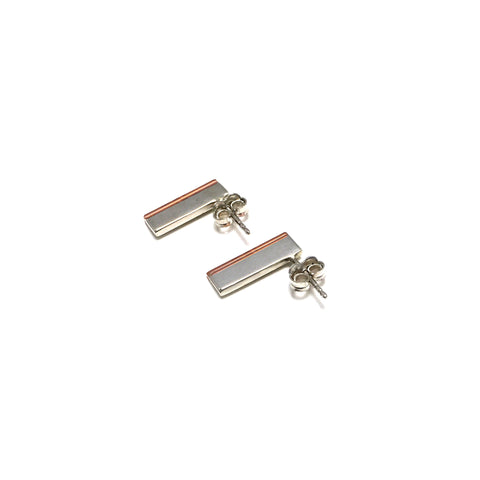 Small side stud earrings created in sterling silver and copper. 15mm x 5mm x 1.5mm