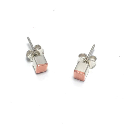 Stud cube earrings created in sterling silver and copper. 4mm x 4mm x 4mm