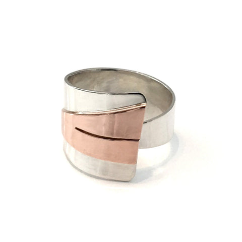 Adjustable triangle ring created in sterling silver and copper. 18mm