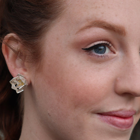 Stud earrings on model by Sorrel van Allen.