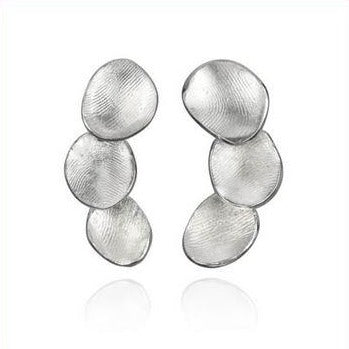 Dorothée Rosen's Triple Moon Pearl Shell Stud earrings are a new design!  Each shell is hand-fabricated, molded in wax and then cast in sterling silver. Their texture is that of Dorothée's fingerprints, the very hand of the maker embedded. Curved, they're just under 4 cm in length.