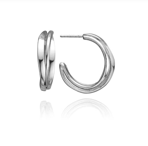 Dorothee Rosen's Original One-footer Design now in Stud Hoop Earrings. Hand-forged, each earring is unique. This pair is in sterling silver.