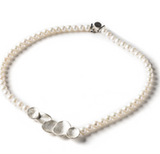"Dorothee Rosen's Moon Pearl Necklace is a new design that shows her fingerprints subtly embedded in the soft silver shells. This necklace is currently available only in a natural rose-coloured pearl and is 18"" in length."