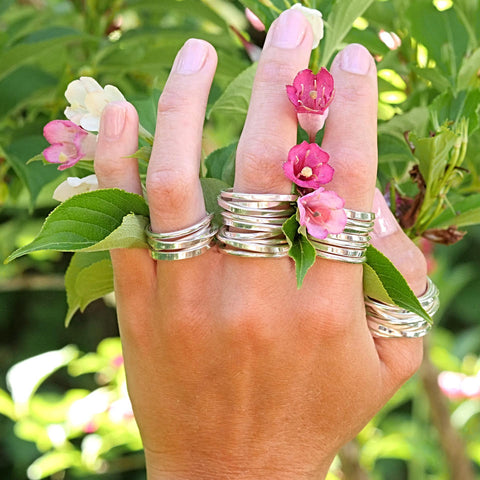 Onefooter Rings in sterling silver--one full forged foot!--in various sizes.  Price is for single ring only.  The style has expanded to include half sizes and goes as large as 3 feet, with a polished or matte finish.  Don't see your size?  Contact us here
