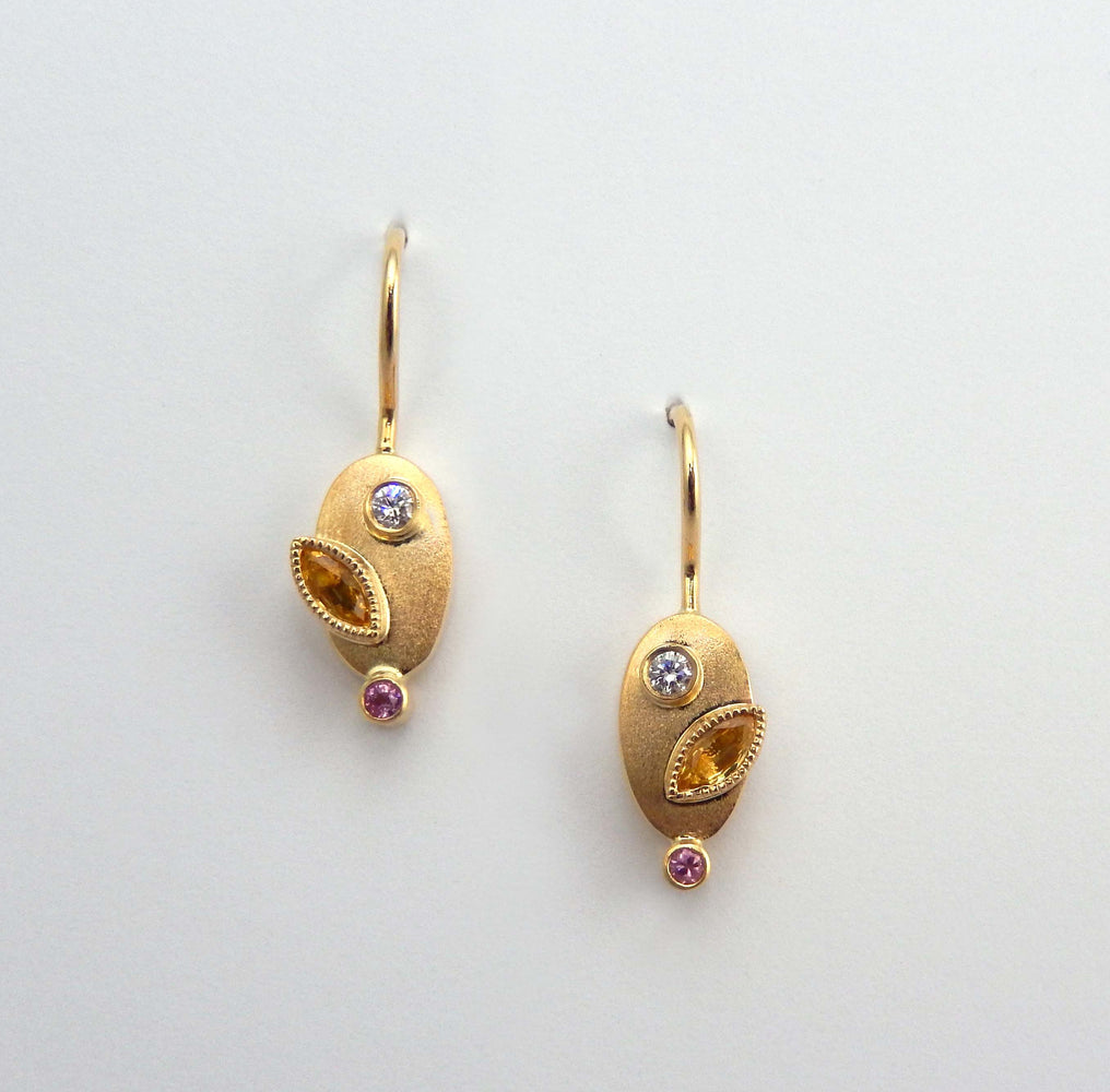 Delicate drop earrings diamonds and sapphires set in 14k yellow gold.