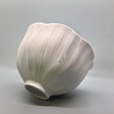 Striped bowl made with the nerikomi ceramic technique.