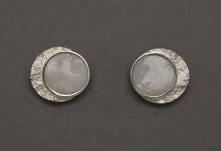Arctic Landscape: Frozen Moon studs in white marble and sterling silver   The white marble for this series was chosen to represent winter ice and snow.  The texture of the crescent moons was made by taking an impression directly from a piece of Arctic granite.  12 mm x 10 mm.