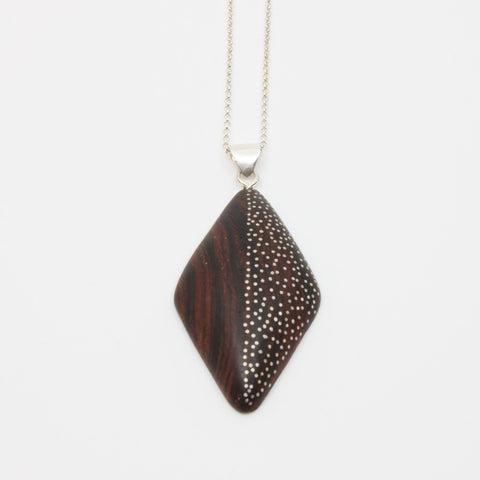 "Delicate rosewood pendant with sterling silver inlay, approx, 4.5 x 2.5 cm on a 20"" sterling silver chain."