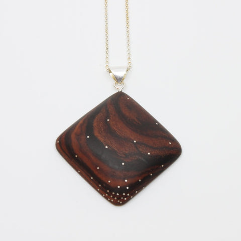 "Delicate rosewood pendant with sterling silver inlay, approx, 4 x 4 cm on a 20"" sterling silver chain."
