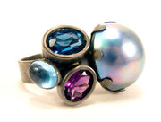 Float Ring.   Black rhodium plated sterling silver, mabe pearl, London blue topaz, Swiss blue topaz, amethyst