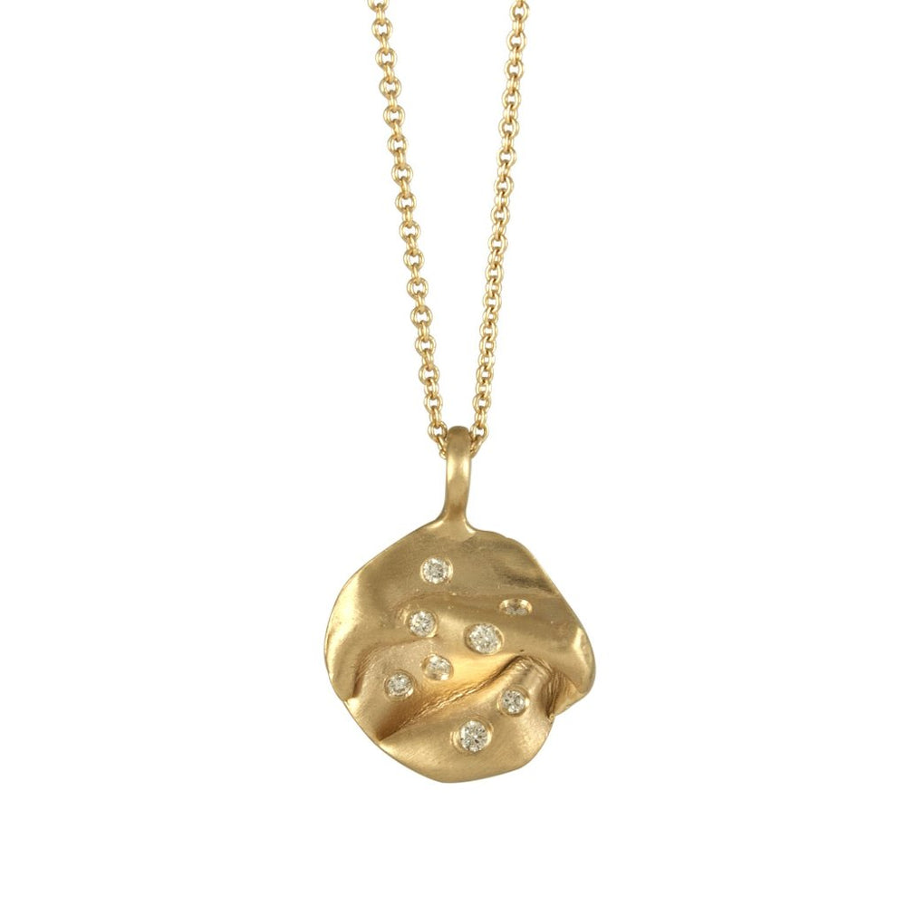 14k gold fold pendant studded with white diamonds.