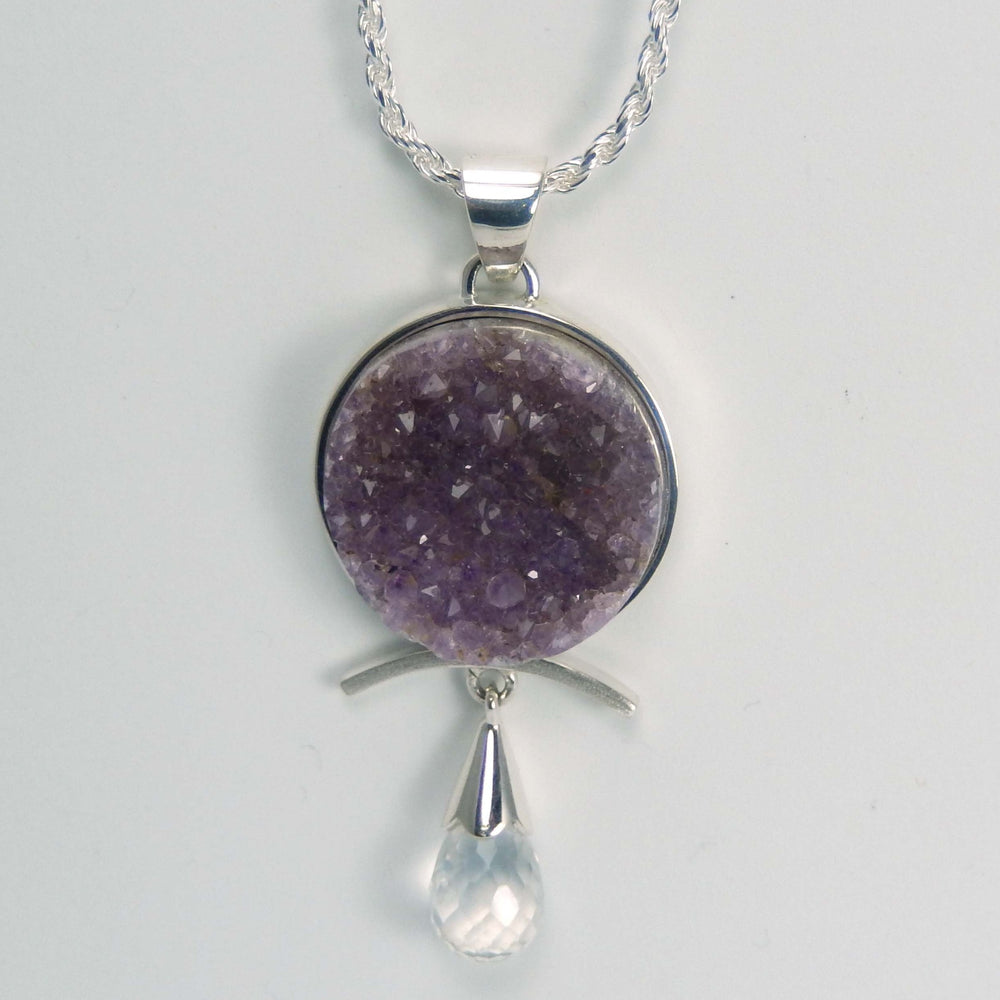 Sterling silver pendant with a druzy amethyst and an ice quartz briolette on a rope chain.