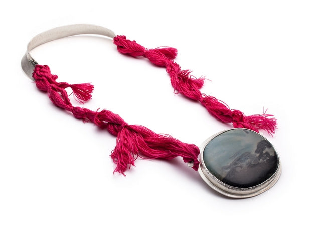 Neckpiece with silk fibers, fine silver, and marble by Gustavo Estrada.
