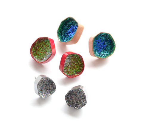 Geode stud earrings in recuperated copper, surgical steel and glitter. Available in silver, red and peach, each pair $80.00.