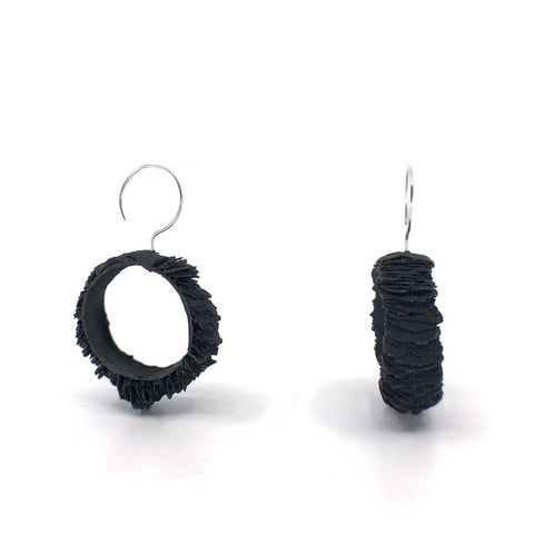 hoops created from sterling silver, paper pulp and acrylic ink