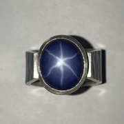 Sapphire Ring - Ripple Collection  Handmade with sterling silver, 18k gold. a star sapphire (synthetic) and two sapphires on each side