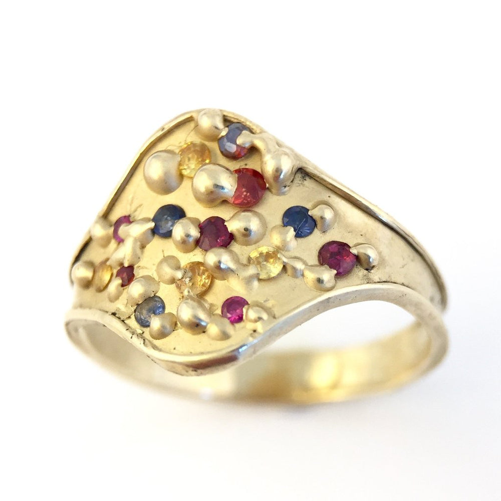 Clown Tears ring in 14kt gold with blue, yellow, and orange sapphires and ruby by Alexandre Bergeron.