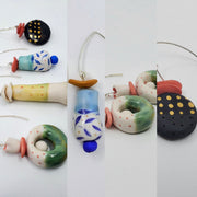 A collection of handmade and hand painted ceramic earrings by Maria Moldovan for La Pai gallery