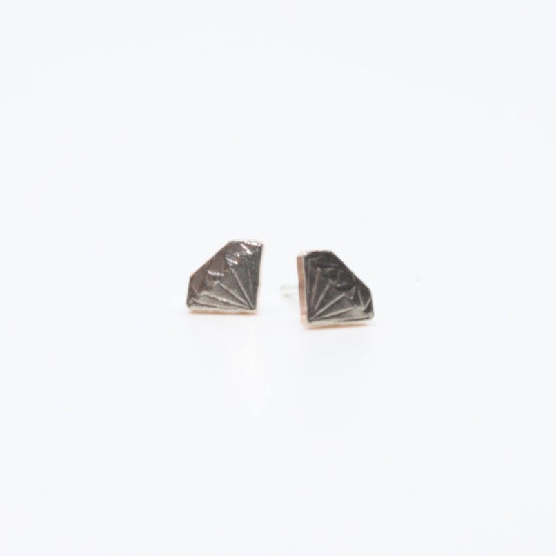 Tiny and precious diamond stud earrings hand sawn from Arkansas coins. Cupronickel clad copper with sterling silver findings.