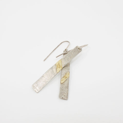 Silver and 18 karat gold drop earrings by Shelley gaffe
