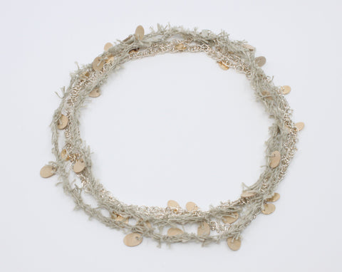 "A long beige linen thread neckpiece with birch plywood tabs mirrors its sterling silver rope twist chain with silver and 10k yellow gold tabs. A sensuous material play, they can be worn singly. 42""/106 cm."