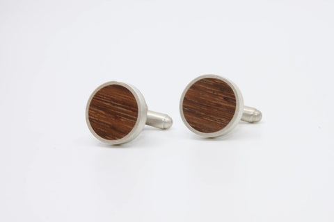 Rosewood cufflinks set in brushed sterling silver.