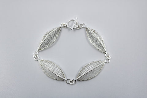"Petal bracelet, hand-woven in sterling silver.   8.5"" long"