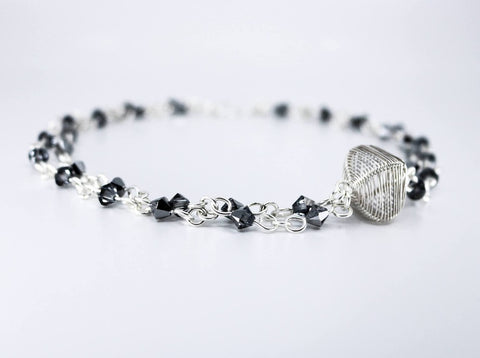 "The Ol' Razzle Dazzle necklace, hand-woven in sterling silver and Swarovski 17.5"" long"