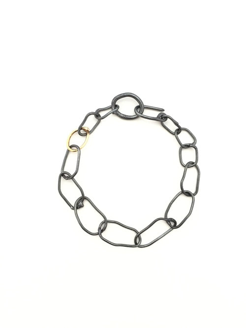 Bracelet in oxidized sterling silver with 14k gold detail by Alexandre Bergeron.